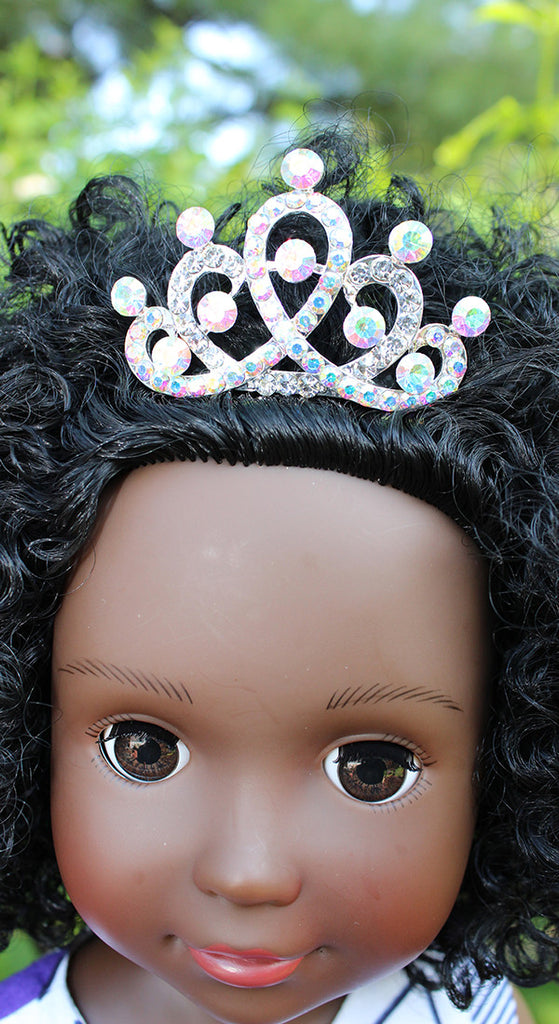 black doll with a crown