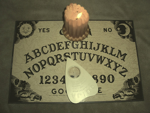 ouija board with candle