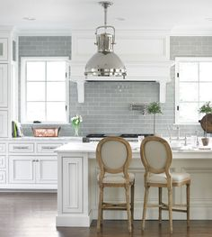 minidal sharp Kitchen with french chairs