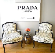 sharp french chair sofa in modern apartment with Prada Poster