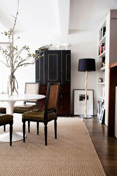 sharp black dining room with french chairs
