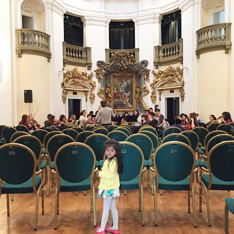 music hall with children. philharmonic italy. perugia umbria countryside