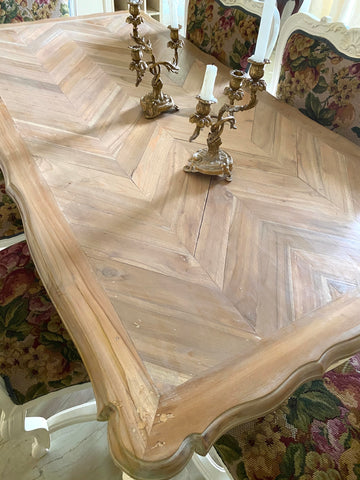 mildly natured wood parquet table top