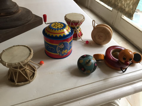 Small acoustic vintage toys like music box, indian drums damroo