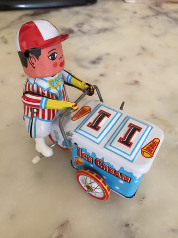 Tin wind up toy ice cream man.