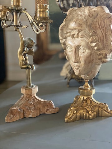 bacchus and a cherub casted in brass. roman mythology.