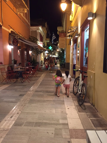 Two girls walking around in the streets of Nafplion in greece. Friendship, love, one world, Travel, vacation, family, travel with children, mediterranean travel