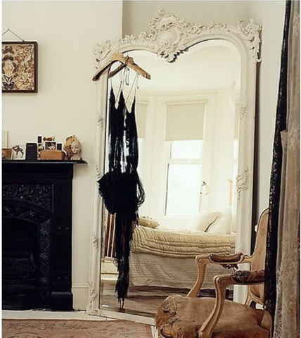 Bohemian chic, oversized mirror. Interior decor