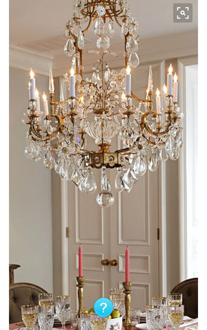very big chandelier in classic dining room. Modern decor with classic baroque luxurious.