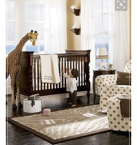brilliant nursery decor inspirations. giraffe toy, cot. white room. gender neutral.