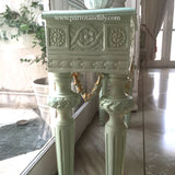 Console table inspired by classic Louis XVI with wreaths