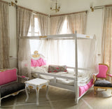 Dainty four poster bed