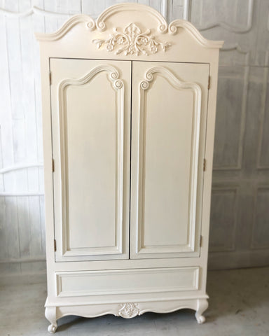Armoire with a drawer and beautiful ornamentation