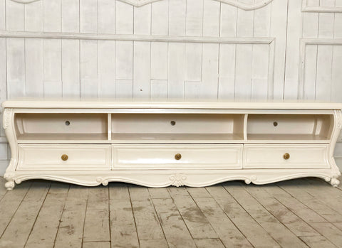 Console for media storage inspired by Louis xv