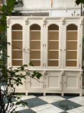 Armoire of Neoclassical features perfect for a Library