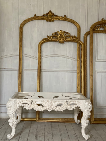 Louis XV center table with lion heads and rare scrolls
