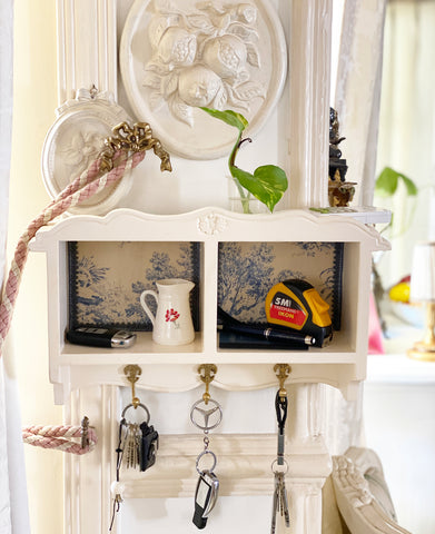 Petite wall shelf with key holders