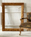 Frame inspired by Louis XIV Era that holds Renoir's  Roses in Vase