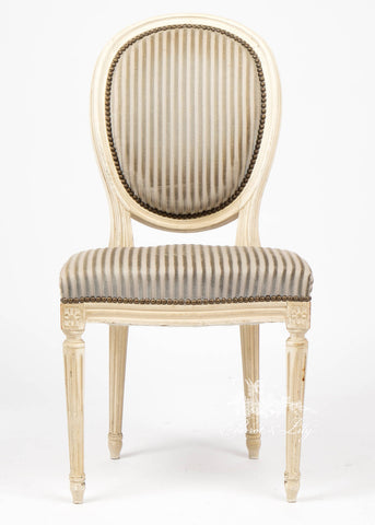 Chair inspired by Classic Louis XVI with sleek frame perfect for dining