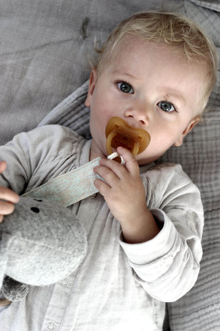 baby with organic soother clip