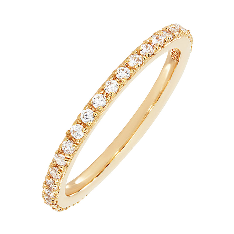 A thin gold stacking ring, embellished in small circular white cubic zirconia stones.