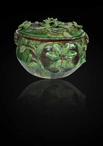 A Continental Tureen and Cover, decorated on a green glazed base with embossed flowers and leaves all round the tureen
