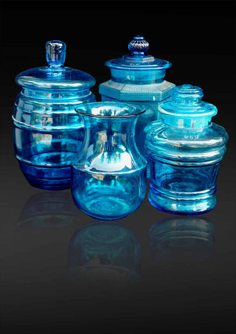 A collection of four blue Venetian glass bins and Indian drinking water lotta