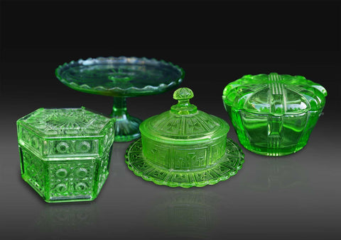 A collection of four Continental green moulded glass boxes, tazza/cake-stand and butter-disc