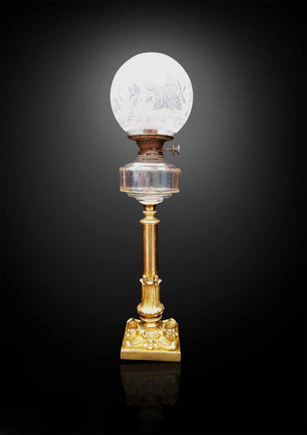 A Victorian brass oil lamp