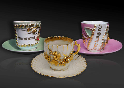 Continental cups & saucers with romantic insignia