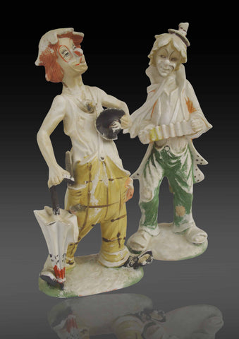 A pair of Continental Biscuit Porcelain figures of musicians