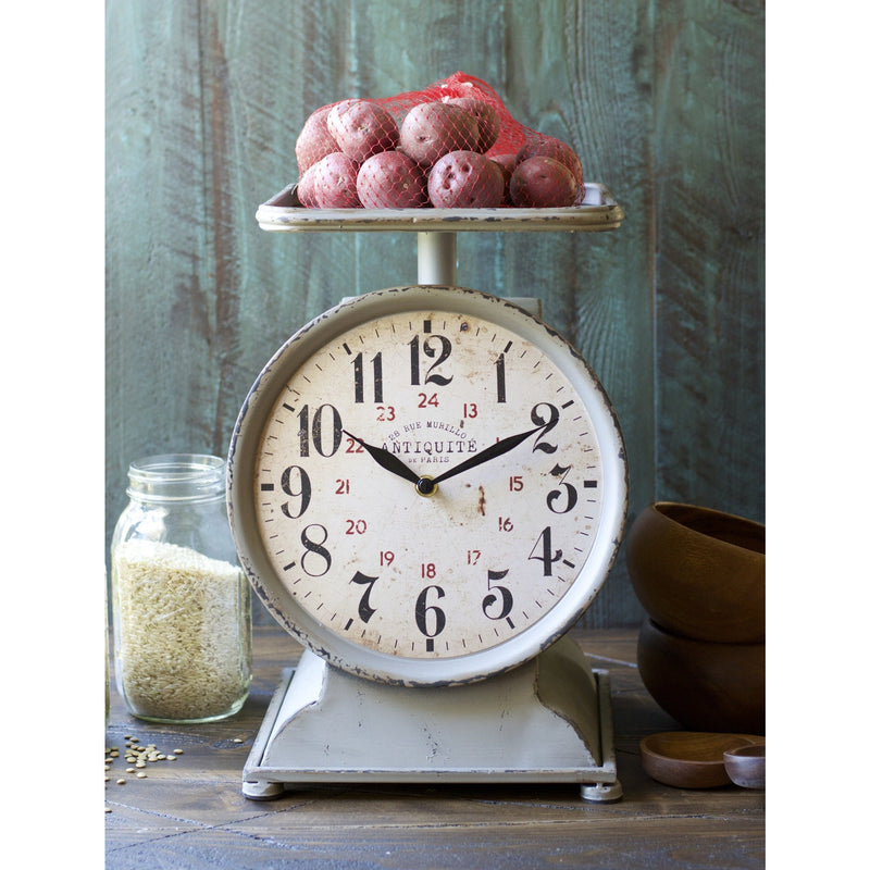 This unique Grocery Scale Clock adds a lovely Farmhouse feel to any kitchen! Set on your counter for a conversation piece!