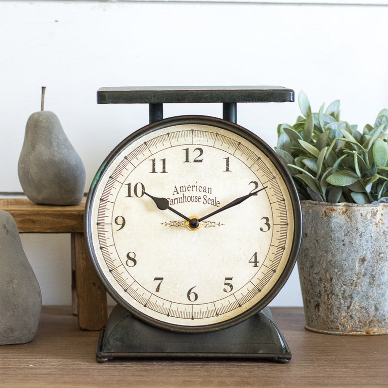 This cute Farmhouse Scale Clock is perfect for decorating small spaces! To bring a bit of vintage charm add this on your counter or open shelving!