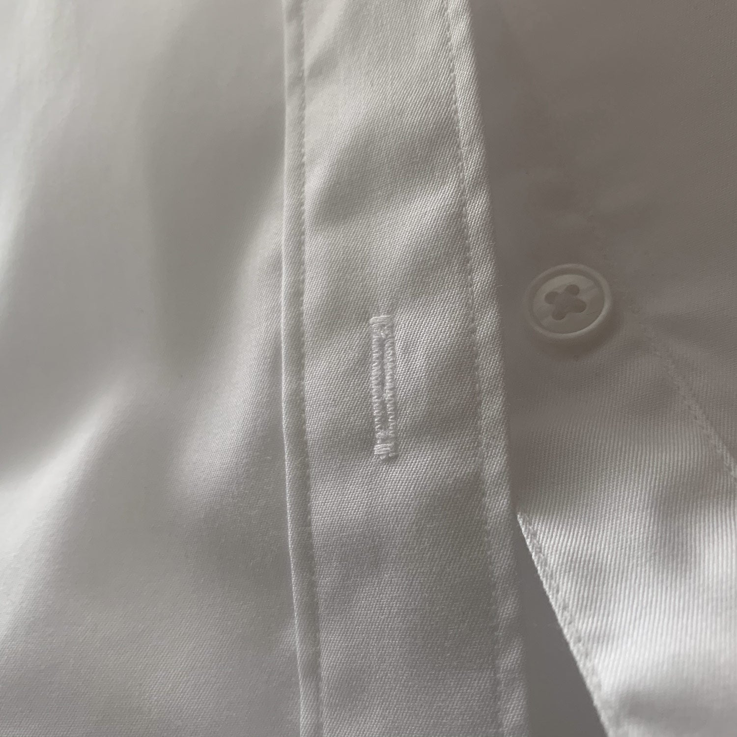 Clean finished button holes on mens shirts image