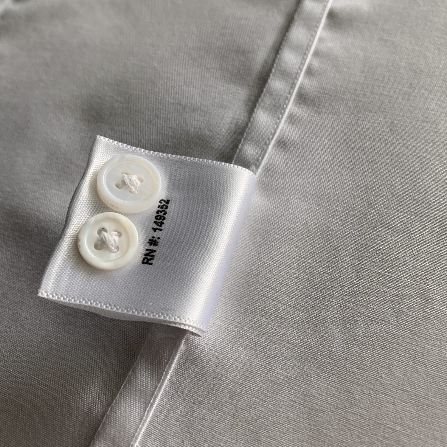 Spare buttons on high quality mens dress shirt