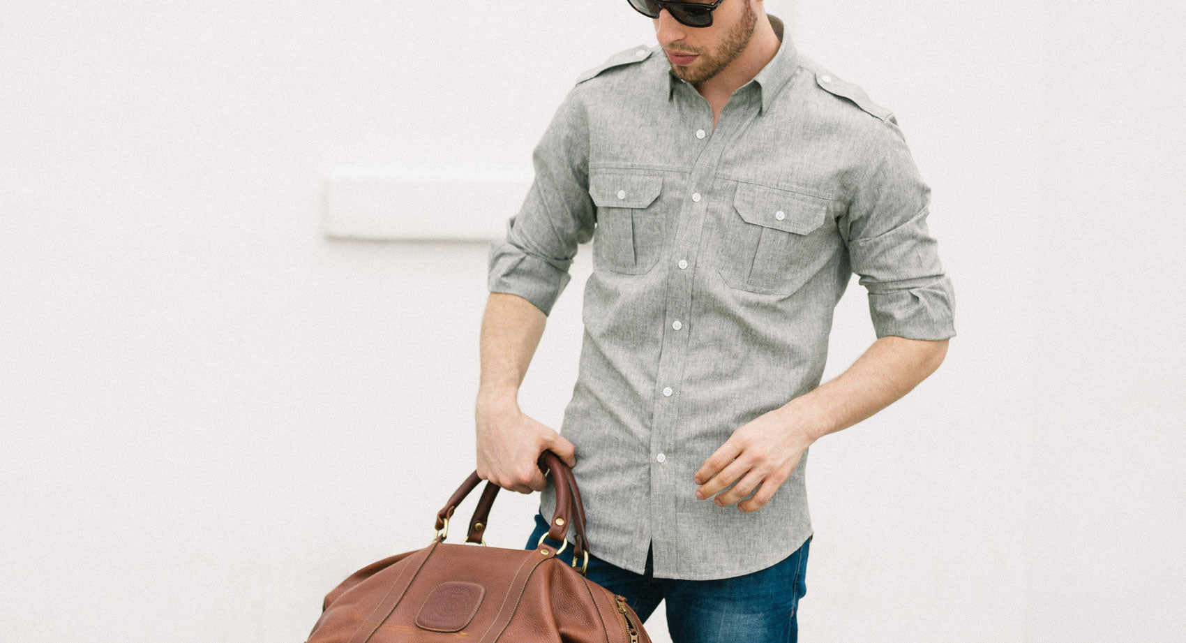 Man wearing blue oxford utility shirt