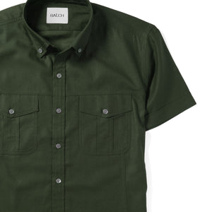 Editor Two Pocket Short Sleeve Men's Utility Shirt In Olive Green Mercerized Cotton Close-Up Image