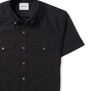 Editor Two Pocket Short Sleeve Men's Utility Shirt In Pure Black Mercerized Cotton Close-Up Image