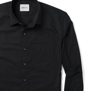 Essential One Pocket Spread Collar Men's Casual Shirt In Jet Black Cotton Oxford With White Stitched Buttons Close-Up Image