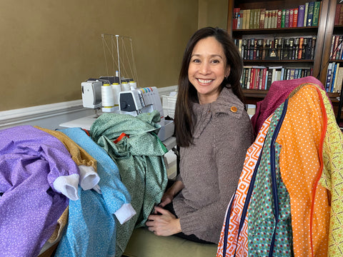 Jennifer Cura, founder of The Patchwork Bear making isolation gowns