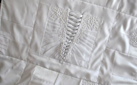 wedding dress quilt using back of wedding dress as focal point