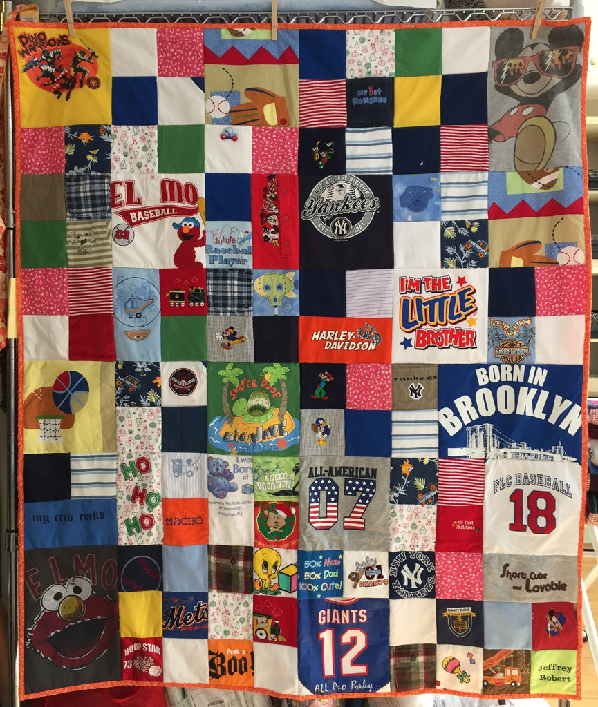 Memory Quilt made from favorite clothes with varied size blocks
