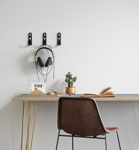 Black wall hooks with brass caps