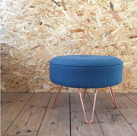 Upholstered footstool with hairpin legs