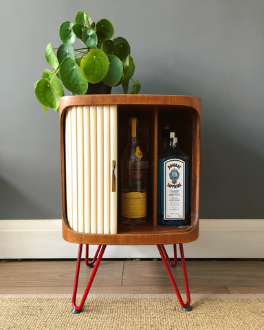 Retro drinks cabinet with red hairpin legs