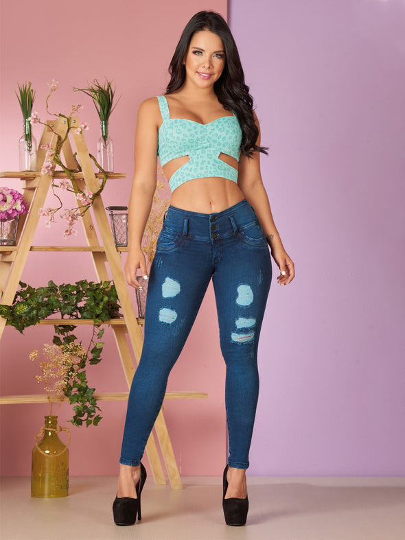 colombian woman wearing mint crop top and butt lift jeans with distress