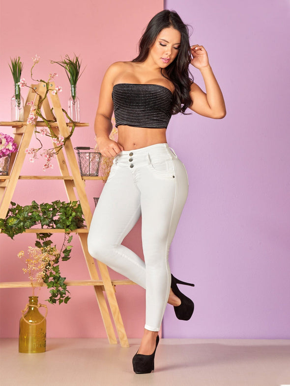 colombian woman wearing white jeans with black top and heels