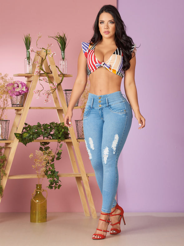 light wash colombian distress jeans with red high heels and crop top