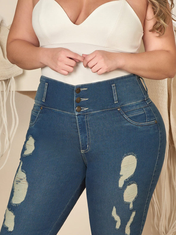 up close view dark wash plus size colombian model wearing distress jeans
