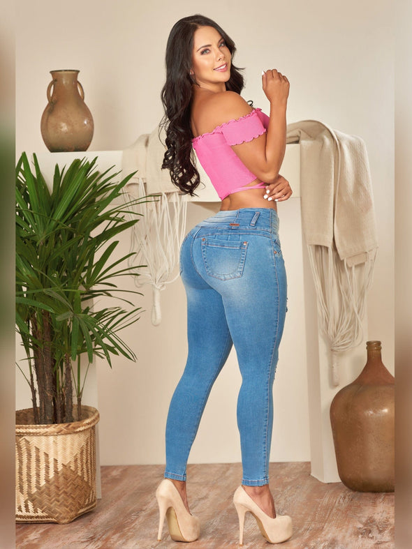 skinny butt lift jeans light wash with pink crop top and nude heells